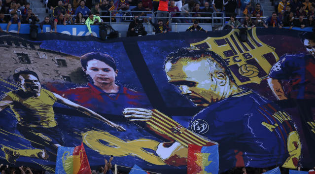 FC Barcelona's supporters display a banner of Barcelona's Andres Iniesta during the Spanish La Liga soccer match between FC Barcelona and Real Sociedad at the Camp Nou stadium in Barcelona, Spain, Sunday, May 20, 2018. Iniesta announced last month he would leave Barcelona after 16 seasons. (AP Photo/Manu Fernandez)