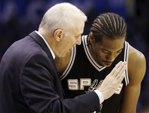 San Antonio Spurs head coach Gregg Popovich, left, talks with Kawhi Leonard (2) during a break against the Oklahoma City Thunder in the first half of Game 3 in their NBA basketball Western Conference finals playoff series, Thursday, May 31, 2012, in Oklahoma City. (AP Photo/Eric Gay)