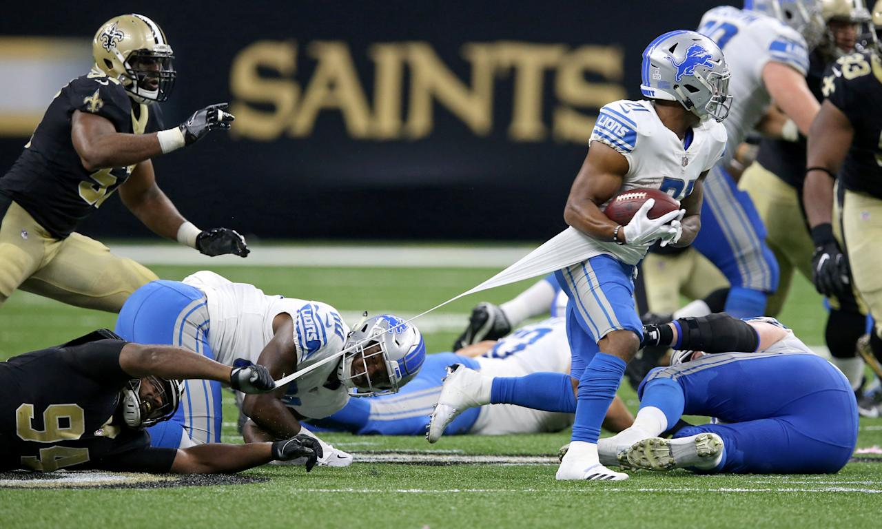 Oct 15, 2017; New Orleans, LA, USA; Detroit Lions running back Ameer Abdullah (21) has his shirt stretched by New Orleans Saints defensive end Cameron Jordan (94) in the second half at the Mercedes-Benz Superdome. Mandatory Credit: Chuck Cook-USA TODAY Sports     TPX IMAGES OF THE DAY