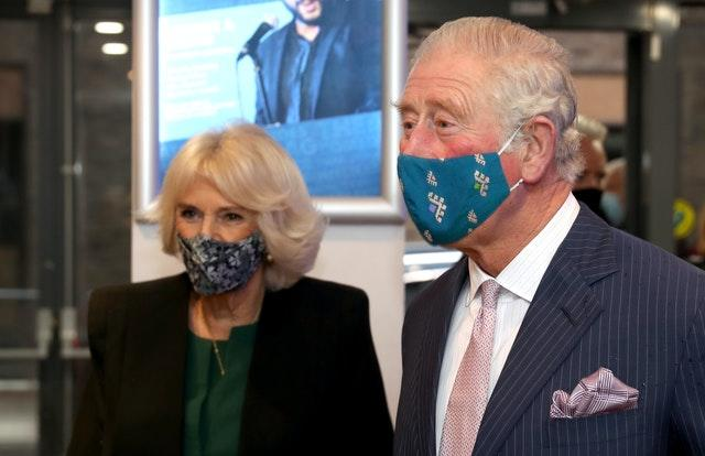 The Prince of Wales and Duchess of Cornwall, wearing masks, during a visit to the Soho Theatre in London. Chris Jackson/PA Wire