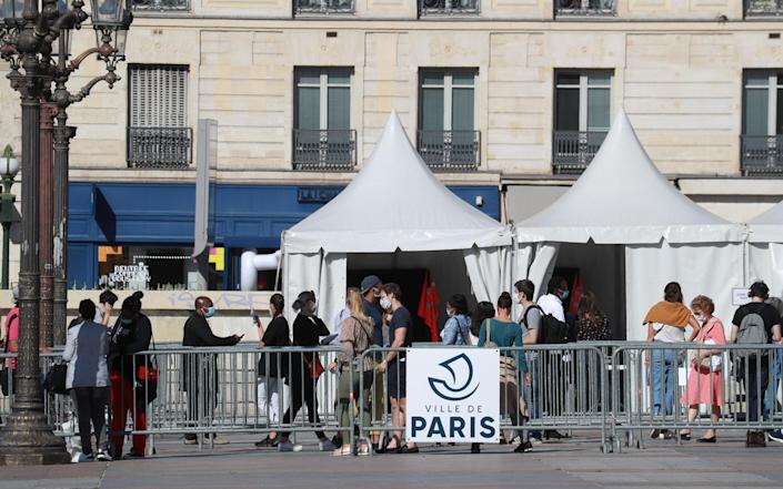 People queue for a test at Hotel de Ville in Paris - Getty