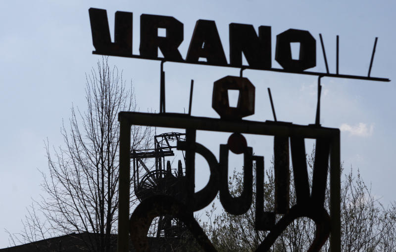 In this photo taken Thursday, April 21, 2011, a sign for a former uranium mine is seen near Pribram, Czech Republic. Deep beneath lush countryside, large pneumatic drills smash rock in search of uranium. An industry once associated here with forced labor, tragic deaths and terminal decline is staging a dramatic comeback. (AP Photo/Petr David Josek)