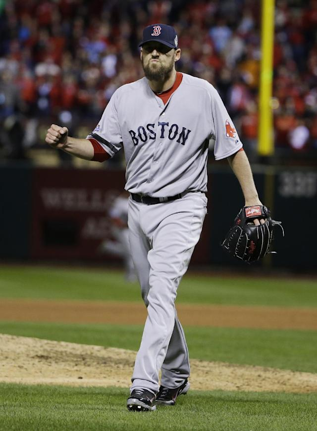 Boston Red Sox starting pitcher John Lackey reacts after St. Louis Cardinals third baseman David Freese grounded out to end the eighth inning of Game 4 of baseball's World Series against the St. Louis Cardinals Sunday, Oct. 27, 2013, in St. Louis. (AP Photo/Matt Slocum)
