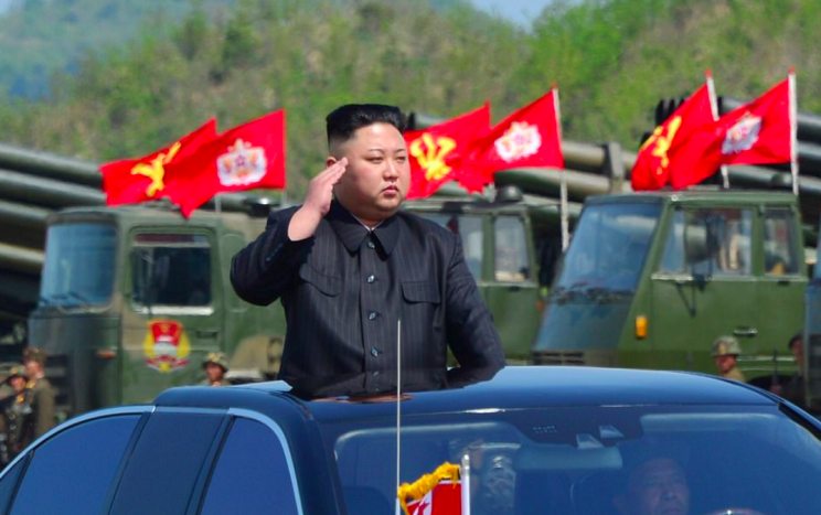Kim Jong-Un saluted the North Korean military from the comfort of his private car. (Pic: Reuters)