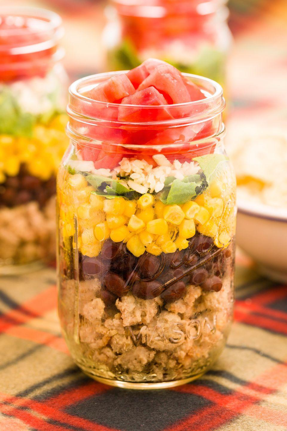 """<p>Layers of ground turkey, black beans, corn, scallions, cheese, and tomatoes is the heartiest thing you can pack in a lunch box.</p><p>Get the recipe from <a href=""""/cooking/recipe-ideas/recipes/a43747/taco-salad-in-a-jar-recipe/"""" data-ylk=""""slk:Delish"""" class=""""link rapid-noclick-resp"""">Delish</a>.</p>"""