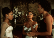 <p>Illusion necklines must have been popular in 1999. For Mia Morgan's wedding in <em>The Best Man</em><em>,</em> actress Monica Calhoun donned a long-sleeve satin gown with that very neckline.<br></p>