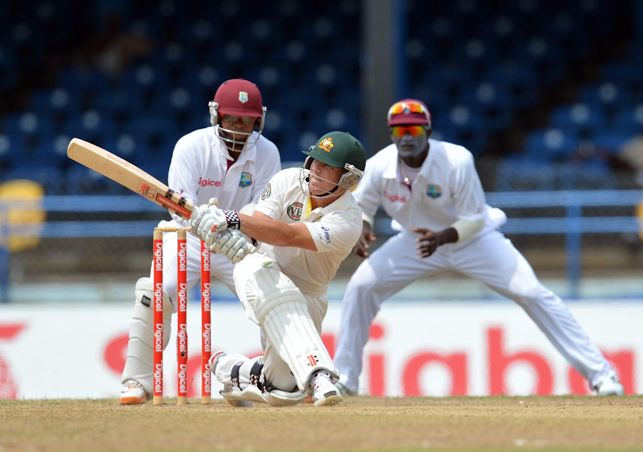Australian batsman David Warner gets a four during the fourth day of the second-of-three Test matches between Australia and West Indies April 18, 2012 at Queen's Park Oval in Port of Spain, Trinidad. AFP PHOTO/Stan HONDA (Photo credit should read STAN HONDA/AFP/Getty Images)