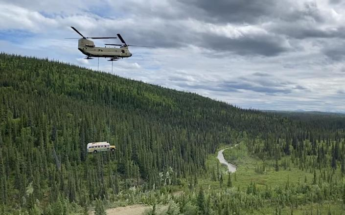The bus was flown away by helicopter over the Alaskan backcountry - ALASKA NATIONAL GUARD HANDOUT/EPA-EFE/Shutterstock/Shutterstock