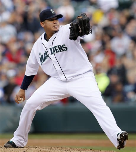 Seattle Mariners starting pitcher Felix Hernandez throws against the Minnesota Twins in the third inning of a baseball game, Saturday, May 5, 2012, in Seattle. (AP Photo/Elaine Thompson)