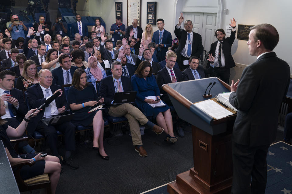 Journalists raise their hands to ask a question as White House national security adviser Jake Sullivan speaks during a press briefing at the White House, Monday, June 7, 2021, in Washington. (AP Photo/Evan Vucci)