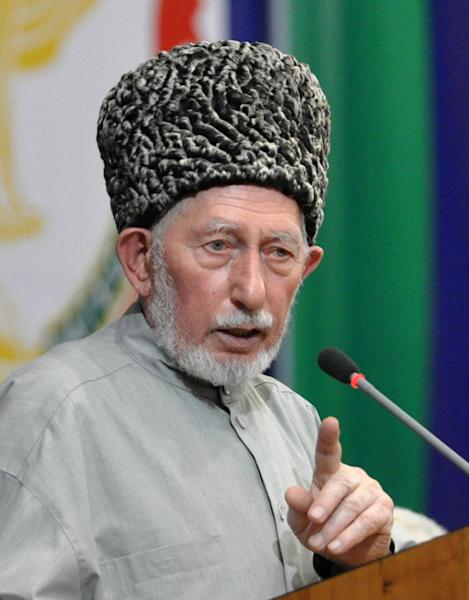 In this photo taken Dec. 15, 2010, Muslim religious leader Said Afandi speaks at a council of Dagestan's peoples assembly in the regional capital Makhachkala, in the Caspian Sea province of Dagestan, southern Russia. Officials in Russia's violence-plagued Dagestan say a top Muslim religious leader and five of his followers have been killed by a suicide bomber. A spokesman for the republic's police said the female bomber blew herself up at the home of Said Afandi in the village of Chirkei. Afandi was a leader of Sufi Muslims and had often publicly criticized the Wahhabi sect that is the core of the insurgency in the republic. (AP Photo/Sergei Rasulov/NewsTeam)