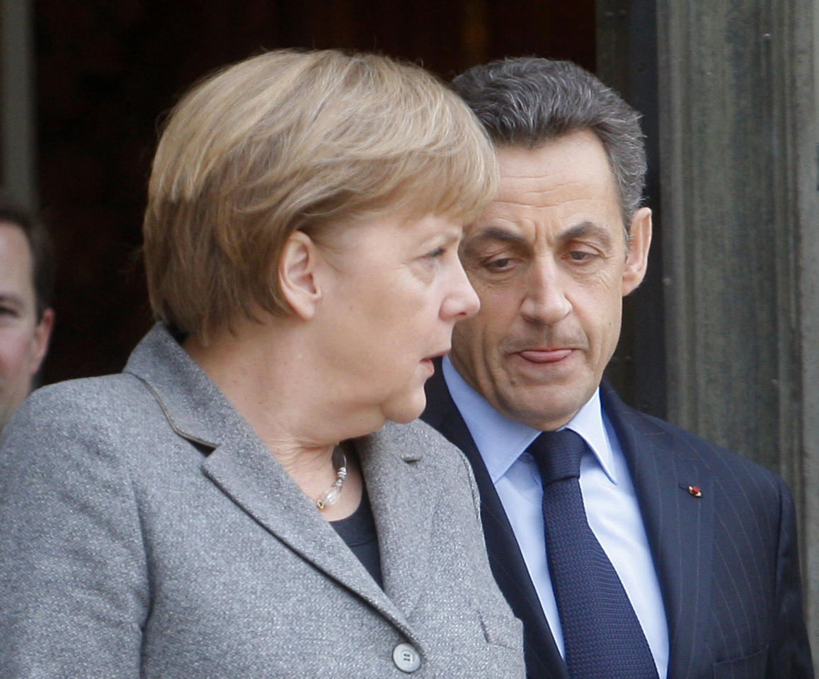 FILE - This is a Feb. 6, 2012 file photo of France's President Nicolas Sarkozy, right, as he bids farewell to German Chancellor Angela Merkel, after a French-German cabinet meeting at the Elysee Palace in Paris. Often these days, the first order of business at European Union summits is not the continent's dreadful financial crisis. It's getting to know the people around the table. The group of national leaders that will meet this week in Brussels is a different crew from the one that met in October 2009, when the crisis in Europe first erupted with the news that Greece was in deep difficulty. (AP Photo/Michel Euler, File)