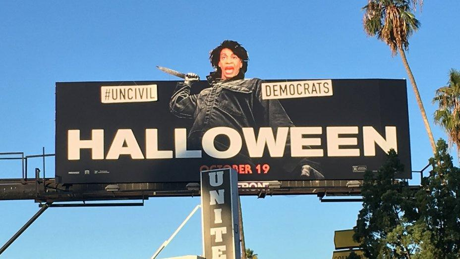 """A street artist transformed a <em>Halloween</em> ad into an attack on Congresswoman Maxine Waters and """"uncivil Democrats."""" (Photo: Sabo)"""