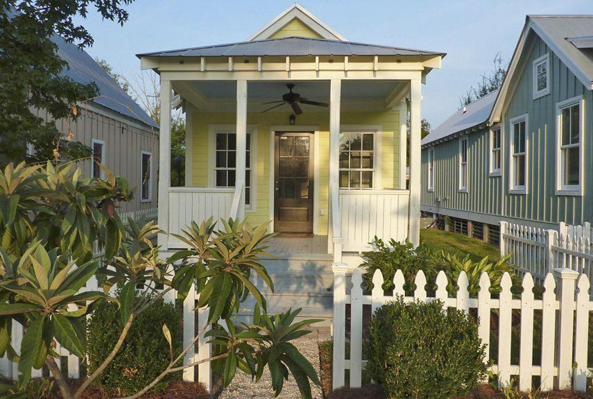 """<p>Designed as an <a href=""""https://www.houseplans.com/collection/katrina-cottages"""" rel=""""nofollow noopener"""" target=""""_blank"""" data-ylk=""""slk:affordable solution"""" class=""""link rapid-noclick-resp"""">affordable solution</a> to the housing crisis after Hurricane Katrina, <a href=""""http://www.mariannecusato.com"""" rel=""""nofollow noopener"""" target=""""_blank"""" data-ylk=""""slk:Katrina Cottages"""" class=""""link rapid-noclick-resp"""">Katrina Cottages</a> start at 308 square feet.</p><p><strong>RELATED: <a href=""""https://www.countryliving.com/real-estate/news/a5392/small-mountain-cottage-home/"""" rel=""""nofollow noopener"""" target=""""_blank"""" data-ylk=""""slk:Tour a Rustic Tiny Mountain Home in Colorado"""" class=""""link rapid-noclick-resp"""">Tour a Rustic Tiny Mountain Home in Colorado</a></strong></p>"""
