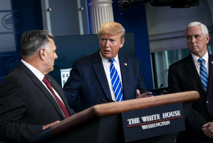 President Donald Trump speaks with Bill Bryan, a Department of Homeland Security official, during a daily coronavirus briefing at the White House in Washington, April 23, 2020. (Al Drago/The New York Times)