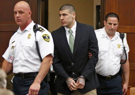 Former NFL player Aaron Hernandez enters the courtroom to be arraigned on homicide charges at Suffolk Superior Court in Boston