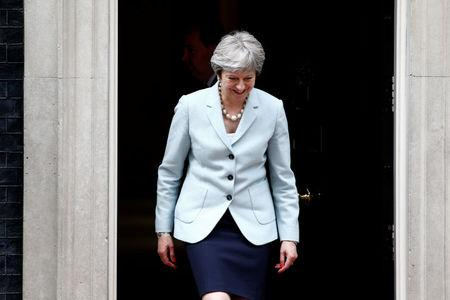 Britain's Prime Minister Theresa May prepares to greet the President of Panama Juan Carlos Varela outside 10 Downing Street, in central London