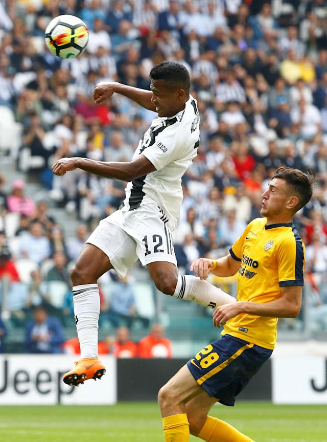 Soccer Football - Serie A - Juventus vs Hellas Verona - Allianz Stadium, Turin, Italy - May 19, 2018 Juventus' Alex Sandro in action with Hellas Verona's Alex Ferrari REUTERS/Stefano Rellandini