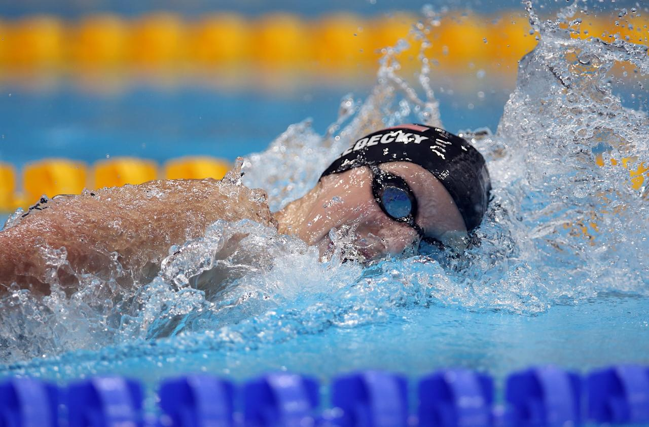 """<p>Back in 2012, Katie Ledecky was a 15-year old high schooler, the baby of the US Olympic swim team, and an athlete full of untried potential. Upsetting the field in the 800-meter freestyle and obliterating a world record ensured that none of her opponents would underestimate her again. Since that breakout performance, Katie has gone on to win six Olympic medals (<a href=""""https://www.popsugar.com/fitness/katie-ledecky-training-tokyo-2020-olympics-46911179"""" class=""""ga-track"""" data-ga-category=""""Related"""" data-ga-label=""""https://www.popsugar.com/fitness/katie-ledecky-training-tokyo-2020-olympics-46911179"""" data-ga-action=""""In-Line Links"""">so far</a>) and <a href=""""https://www.popsugar.com/fitness/Katie-Ledecky-Wins-800m-at-2019-World-Championships-46488638"""" class=""""ga-track"""" data-ga-category=""""Related"""" data-ga-label=""""https://www.popsugar.com/fitness/Katie-Ledecky-Wins-800m-at-2019-World-Championships-46488638"""" data-ga-action=""""In-Line Links"""">15 world titles</a>, the undeniable, practically-unbeatable superstar of swimming.</p>"""