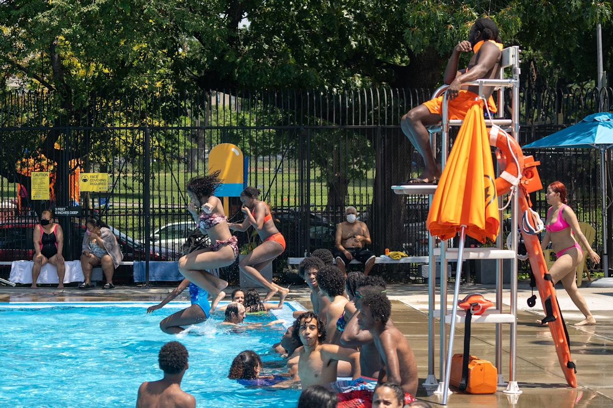People enjoy the pool at Mullaly Park on the second day of opening following the phase four guideline in response to the COVID-19 pandemic on July 25, 2020, in the Bronx borough of New York City.