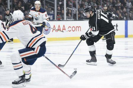 Nov 25, 2018; Los Angeles, CA, USA; Los Angeles Kings center Anze Kopitar (11) handles the puck against the Edmonton Oilers during the second period at Staples Center. Mandatory Credit: Kelvin Kuo-USA TODAY Sports