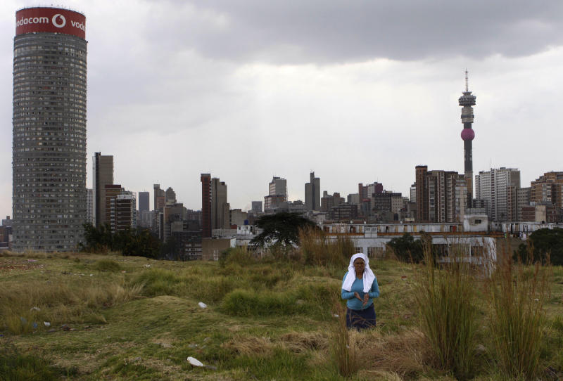 "A worshipper atop a hill overlooking Johannesburg offers Good Friday prayers and prayers for the quick recovery of former president Nelson Mandela Friday, March 29, 2013. A lung infection that has plagued Nelson Mandela has struck again, prompting doctors to admit the 94-year-old former president to a hospital late at night. The presidency said Friday that Mandela was making ""steady progress"" during hospital care. (AP Photo/Denis Farrell)"