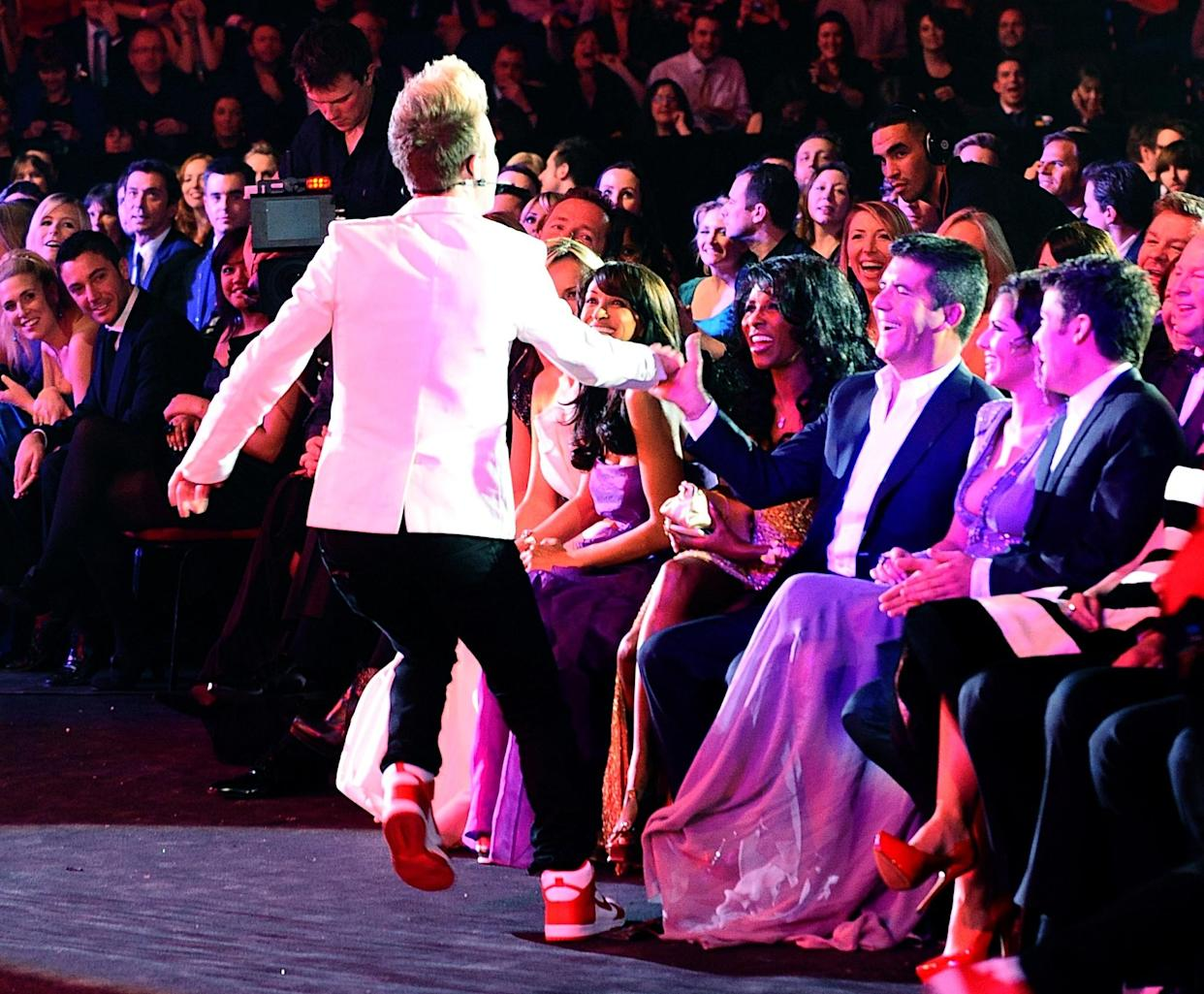 Jedward joke with Simon Cowell during the National Television Awards 2010, at the 02 Arena, London.