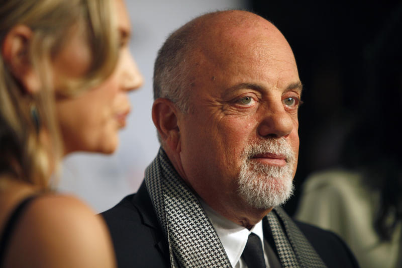 "Billy Joel arrives at the Elton John AIDS Foundation's 12th Annual ""An Enduring Vision"" benefit gala at Cipriani Wall Street on Tuesday, Oct. 15, 2013 in New York. (Photo by Carlo Allegri/Invision/AP)"