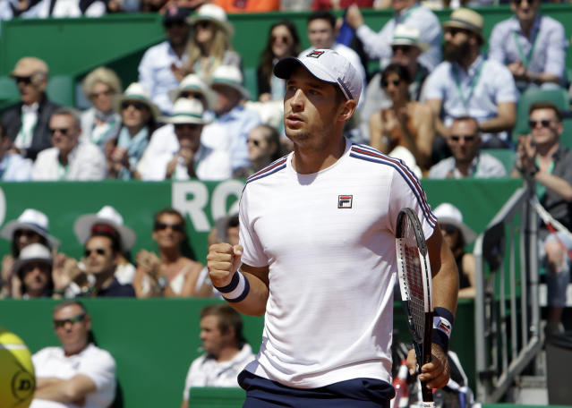 Serbia's Dusan Lajovic celebrates after winning a point against Russia's Daniil Medvedev during their semifinal match of the Monte Carlo Tennis Masters tournament in Monaco, Saturday, April 20, 2019. (AP Photo/Claude Paris)