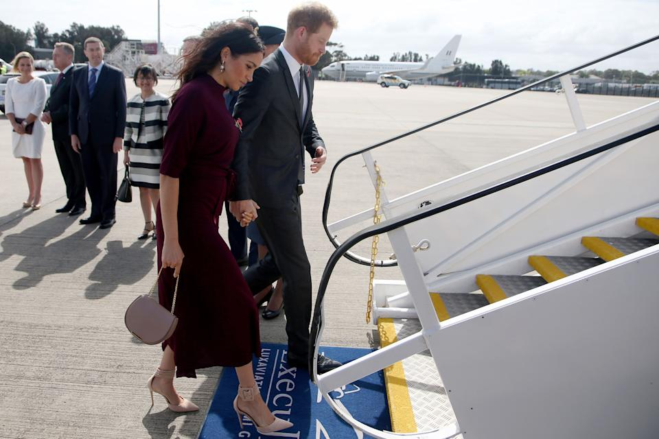 Prince Harry and Meghan Markle board plane in Sydney