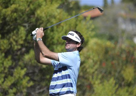 Feb 16, 2014; Pacific Palisades, CA, USA; Bubba Watson (USA) hits on the fourth hole during the fourth round of the Northern Trust Open at Riviera Country Club. Andrew Fielding-USA TODAY Sports