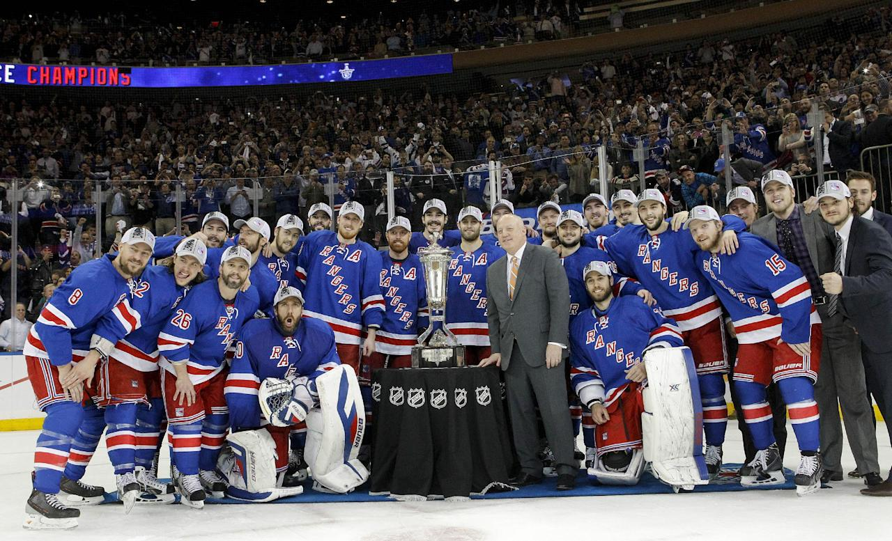 The New York Rangers pose for a photo with the Prince of Wales Cup after beating the Montreal Canadiens 1-0 in Game 6 of the NHL hockey Stanley Cup playoffs Eastern Conference finals, Thursday, May 29, 2014, in New York. (AP Photo/Kathy Willens)