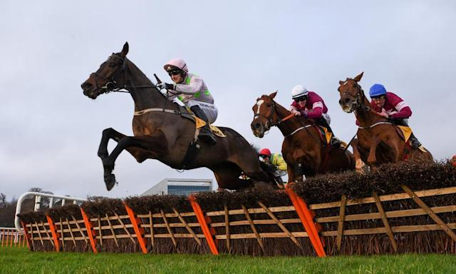 <span>Sharjah, ridden by Patrick Mullins, jumps the last ahead of Samcro (Jack Kennedy, white cap) who fades into fifth. </span> <span>Photograph: David Fitzgerald/Sportsfile via Getty Images</span>