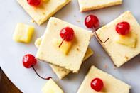 <p>Transport yourself to the tropics with these lightened-up cheesecake bars.</p><p>Get the Skinny Pineapple Cheesecake Bars recipe.</p>