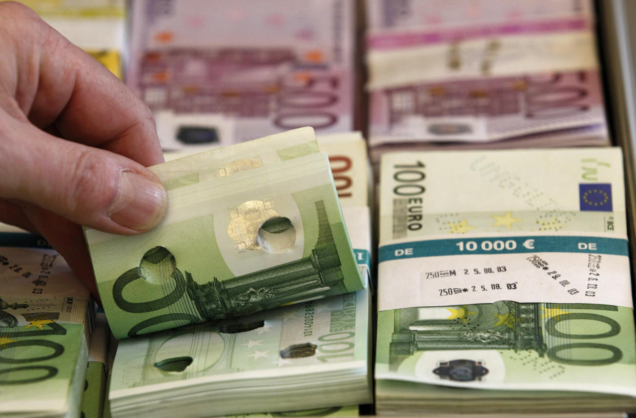 Punctured euro banknotes which are used to train sniffer dogs, are presented to the media during a news conference on German custom's annual statistics, in Berlin March 21, 2014. REUTERS/Tobias Schwarz (GERMANY - Tags: POLITICS BUSINESS)