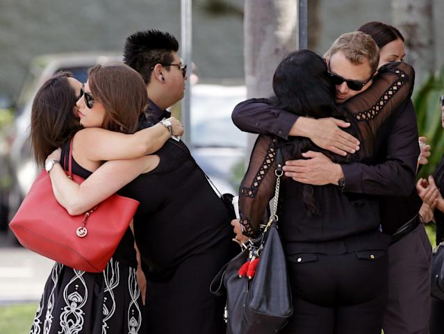 <p>Mourners embrace outside the funeral service for Anthony Luis Laureano Disla, one of the victims of the Pulse nightclub mass shooting, on June 17, 2016, in Orlando. (Photo: John Raoux/AP) </p>