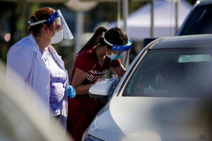 FILE PHOTO: COVID-19 mass-vaccination of healthcare workers takes place at Dodger Stadium in Los Angeles