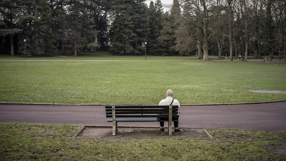 Pictured is a person sitting on a park bench. Vienna police handed a fine to a man who let out a fart 'with full intent'.