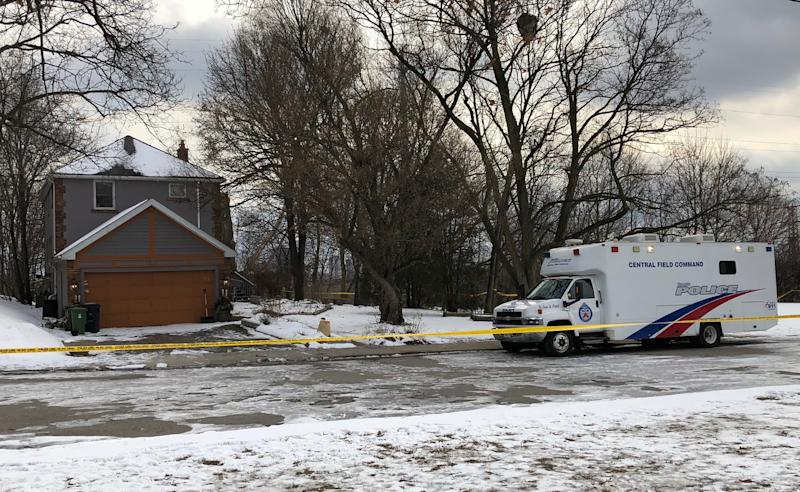 In this Saturday, Feb. 3, 2018 photo, crime scene tape surrounds a property where police say they recovered the remains of at least six people from planters on the property which is connected to alleged serial killer Bruce McArthur, in Toronto, Canada. A Toronto detective said the remains, found on property McArthur used as storage in exchange for doing the landscaping, included some from one of the five men McArthur is already charged with killing, Andrew Kinsman. (AP Photo/Rob Gilles)