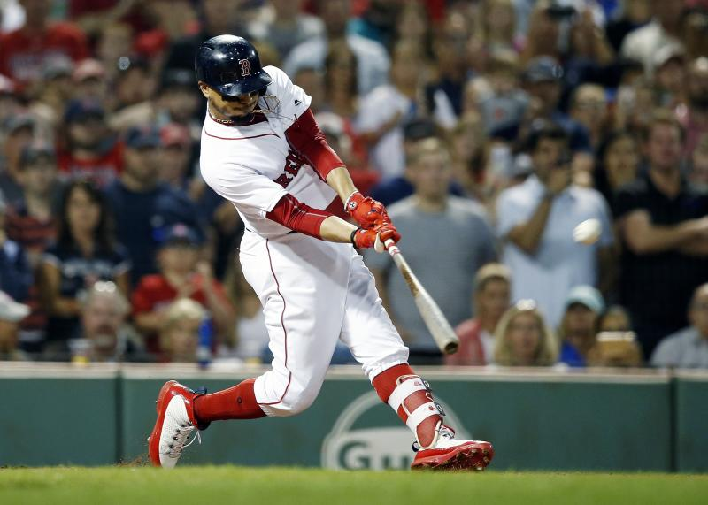 Boston Red Sox's Mookie Betts hits a grand slam during the fourth inning against the Toronto Blue Jays in a baseball game in Boston, Thursday, July 12, 2018. (AP Photo/Michael Dwyer)