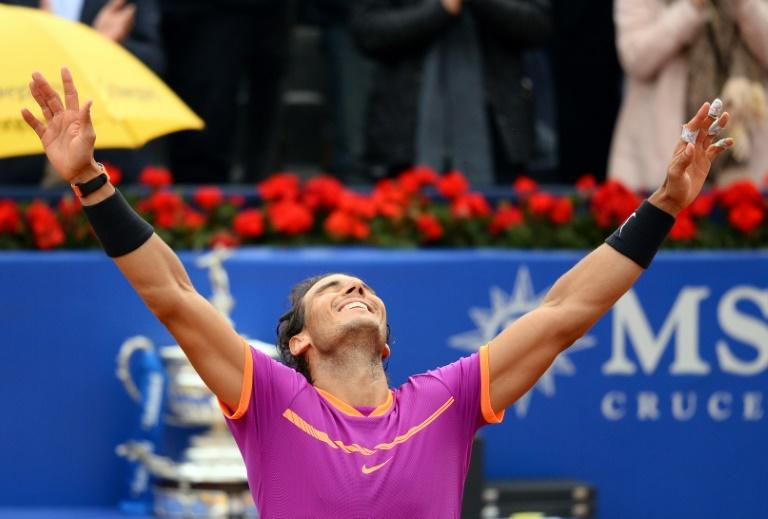 Spanish tennis player Rafael Nadal celebrates his victory over Austrian tennis player Dominic Thiem at the end of the ATP Barcelona Open on April 30, 2017