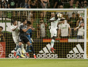 Austin forward Moussa Djitté heads the ball away from the goal during the first half of an MLS soccer match against the LA Galaxy, Sunday, Sept. 26, 2021, in Austin, Texas. (AP Photo/Michael Thomas)