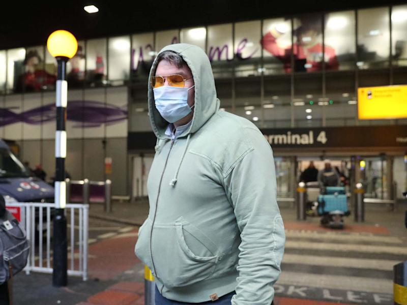 Passengers outside Heathrow Terminal 4, London, as the government met to discuss the threat from coronavirus: PA
