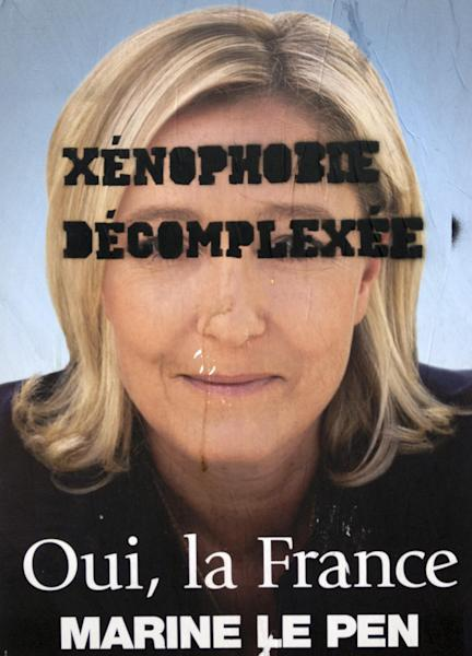 "An electoral poster of French far-right leader and National Front Party candidate for the 2012 French presidential elections, Marine Le Pen, with ""Xenophobia Uninhibited"" written on it, is displayed in Paris, Wednesday, April 18, 2012. The first round of the election will take place on April 22, followed by a second round on May 6, 2012. (AP Photo/Francois Mori)"