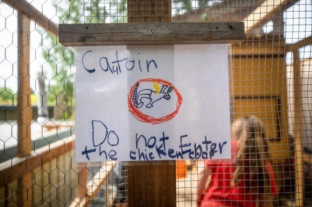 A hand-printed sign on the hen house.