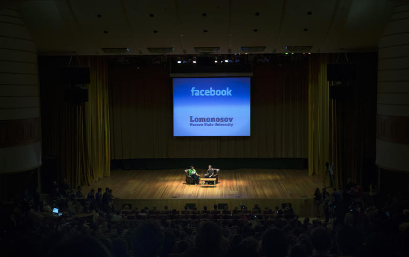 FILE -In this  Tuesday, Oct. 2, 2012, file photo, Facebook CEO Mark Zuckerberg, center,  addresses students of Moscow's State University in Moscow,  Russia.  Facebook's third-quarter results released Tuesday, Oct. 23, 2012, inched past Wall Street's expectations, offering evidence that the company is making inroads in mobile advertising, a longtime concern among investors. (AP Photo/Alexander Zemlianichenko)