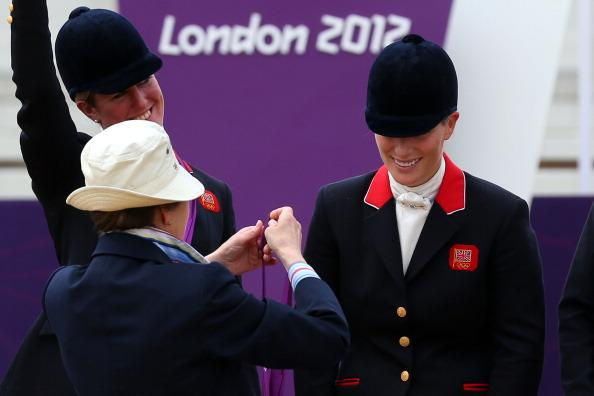 Zara Phillips is presented a silver medal by her mother, Princess Anne, the Princess Royal, after the Eventing Team Jumping Final Equestrian event on Day 4 of the London 2012 Olympic Games at Greenwich Park in London, England on July 31, 2012. | Alex Livesey—Getty Images