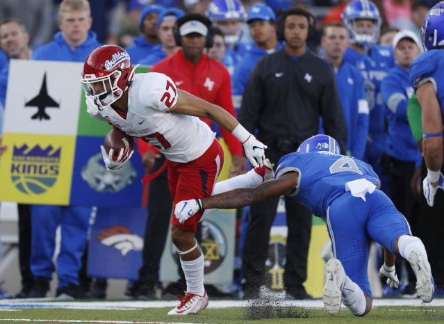 Fresno State wide receiver Zane Pope, left, breaks free from Air Force defensive back James Jones IV after pulling in a pass in the first half of an NCAA college football game Saturday, Oct. 12, 2019, at Air Force Academy, Colo. (AP Photo/David Zalubowski)