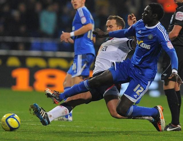 "Macclesfield Town's Guinean midfielder Arnaud Mendy (R) vies with Bolton Wanderers' English forward Kevin Davies during the English FA Cup third round reply football match between Bolton and Macclesfield at The Reebok stadium, in Bolton, north-west England on January 17, 2012. (Photo by Andrew Yates. Restricted To Editorial Use. No Use With Unauthorized Audio, Video, Data, Fixture Lists, Club/league Logos Or ""live"" Services. Online In-match Use Limited To 45 Images, No Video Emulation. No Use In Betting, Games Or Single Club/league/player Publications./AFP/Getty Images)"