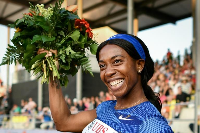 Jamaica's Shelly-Ann Fraser-Pryce celebrates after winning the women's 100m at the Diamond League meeting in Lausanne